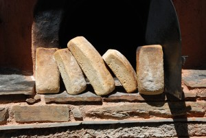 "Making bread in the Clay oven ""Horno"" is rather easy."